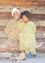 The head priest of Malana with a village girl