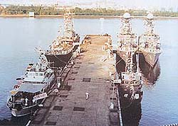Line-up of Indian Naval ships on Mumbai dockyard breakwater during the crucial three days of the Rin Mutiny.