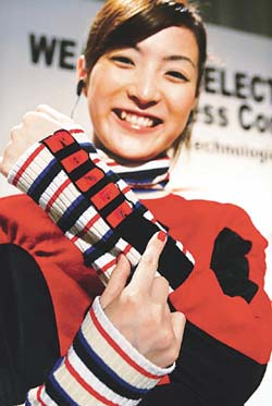 Slightly crooked (yet strangely appealing) teeth, funky fashion sense, great smile, spotless face - yup, Japanese girl. w00t!!!