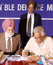Defence Minister George Fernandes with Marshal of the Indian Air Force Arjan Singh during the launch of  Biography of the Marshal of the Indian Air Force Arjan Singh, DFC, in the Capital on Wednesday. Author Roopinder Singh, Assistant Editor, The Tribune, is also in the picture. — Tribune photo Mukesh Aggarwal