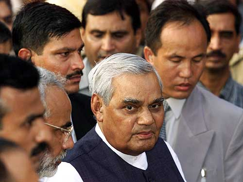 Prime Minister Atal Behari Vajpayee speaks to newsmen after a visit to the Akshardham temple