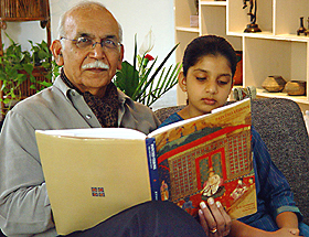 "Dr B N Goswamy and his granddaughter Damini browsing through his book on Indian costumes that is considered a ""Bible"" by many top designers."