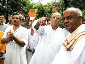 Former Prime Ministers V.P. Singh, H.D. Deve Gowda and senior CPM  leader Sita Ram Yechuri during a demonstration against the World Trade  Organisation in New Delhi on Tuesday