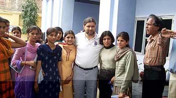 Mr Jean-Pierre Harrison, husband of Kalpana Chawla, with students of