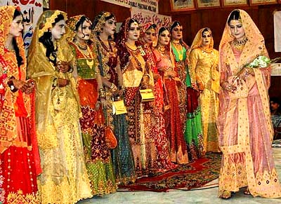 Women take part in a bridal dress show to celebrate new year in multan