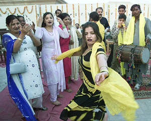 Pakistani women dance to celebrate Basant, a traditional spring