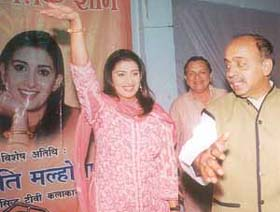 TV artiste Smriti Irani Malhotra with BJP MP Vijay Goel at a cultural function in Timarpur in the Capital