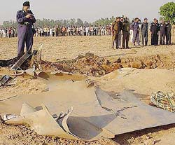 Air Force officers inspect the wreckage of the Jaguar which crashed in Ambala on Thursday.