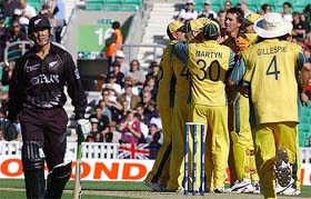Australian Players Celebrate The Dismissal Of New Zealands Nathan Astle During Their ICC Champions Trophy Match