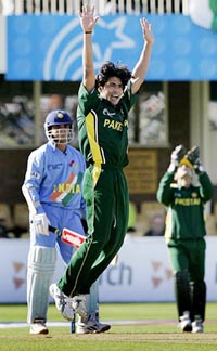 Pakistans Mohammed Sami Celebrates The Wicket Of India Captain Sourav Ganguly During Their ICC Champions Trophy