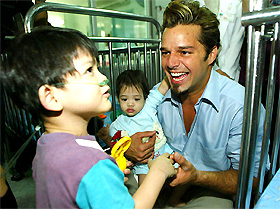Pop star Ricky Martin plays with orphans at a Thai Red Cross Children's Home in Bangkok on Wednesday