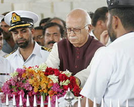 Lal Krishan Advani lays a flower wreath at the mausoleum of Mohammed Ali Jinnah, founding father of Pakistan, in Karachi on June 4 2005.