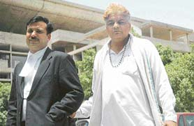 Mr Naresh Kumar Kadyan and his counsel in the Punjab and Haryana High Court on Tuesday in Chandigarh.