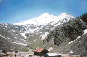 A view of the snow-clad Rohtang from Madhi