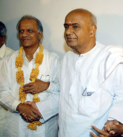 Former  Prime Minister and JD(S) President H.D. Deve Gowda greets newly elected  Deputy Chief Minister and leaderof JD (S) legislative party M.P. Prakash  at his residence in Bangalore on Thursday.