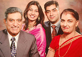 A file picture of Capt Sumit Kohli (right) with his wife Deepika and parents.