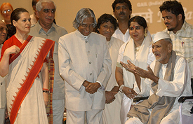 Bismillah Khan gestures as Indian President A.P.J. Abdul Kalam, BJP leader Jaswant Singh and Congress president Sonia Gandhi look on prior to a concert at Parliament House in New Delhi