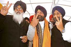 Former Punjab Chief Minister Parkash Singh Badal, Mr Harinder Pal Singh and Mr Sukhbir Badal at a party meeting in Patiala