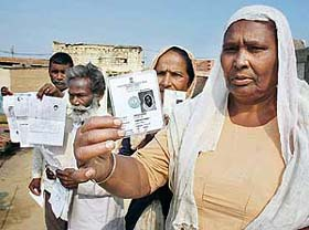 Beant Nagar residents show their voter identity cards in Bathinda