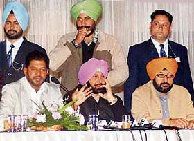 Chief Minister Amarinder Singh, flanked by Mr Satnam Singh Kainth (right) and Mr Jassi Khangura, addresses a press conference in Ludhiana
