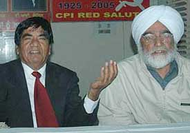 Dr Joginder Dyal (left), member, national executive of the CPI, and Prof Balwant Singh, state secretary of the CPM, at a joint press conference in Chandigarh on Sunday.