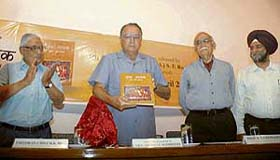 UT Administrator Gen S F Rodrigues (retd) releases the Hindi translation of �Guru Nanak: His Life and Teachings� by Roopinder Singh (extreme right) along with Mr H K Dua, Editor-in-Chief of The Tribune (extreme left) and eminent historian Dr B N Goswami.