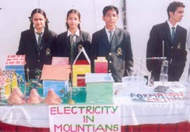Students display their models at a science exhibition in adur