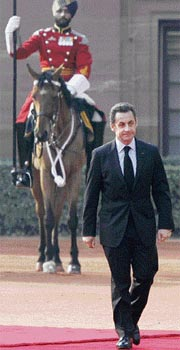 France's President Nicolas Sarkozy reviews troops at Rashtrapati Bhawan on Friday.