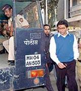 Maharashtra Navnirman Sena chief Raj Thackeray is escorted after his arrest at his residence in Mumbai on Wednesday.