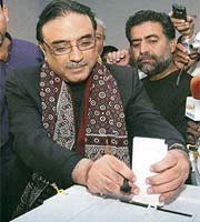 Asif Ali Zardari, widower of Benazir Bhutto, casts his ballot inside a polling station in Nawabshah, 320 km from Karachi