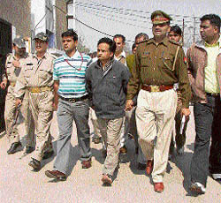 K.K. Aggarwal, an accused in the kidney racket and accomplice of Dr Amit, being produced in a court in Ambala on Wednesday.