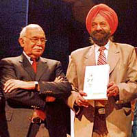 "Tarlochan Singh, MP, releases the book ""Giani Gurdit Singh 1923-2007"" at Punjab Kala Bhavan in Chandigarh on Sunday, while Prof B.N. Goswamy looks on."