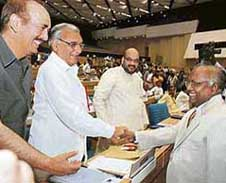 Haryana Chief Minister Bhupinder Singh Hooda shakes hands with Chief Justice of India K.G. Balakrishnan at a conference of Chief Ministers and Chief Justices of the high courts in New Delhi on Saturday.