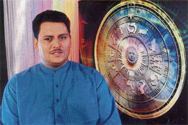 Pawan Sharma, astrologer-cum-anchor of Zee Punjabi's twin astrology