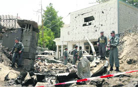 The damaged  facade of the Indian embassy after a suicide attack at the site in Kabul on Monday.