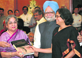 Prime Minister Manmohan Singh and his wife Gursharan Kaur with daughter Upinder Singh on the occasion of the launch of her book