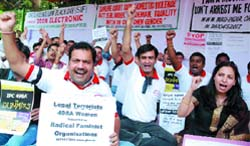 Members of Save Family Foundation and NGOs hold a dharna to protest against the misuse of women protection laws