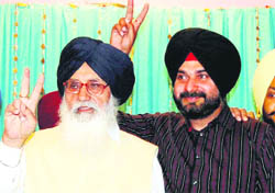 Chief Minister Parkash Singh Badal and Navjot Singh Sidhu show victory sign in Amritsar on Monday.