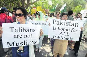 Pakistani citizens rally against the Taliban in Lahore