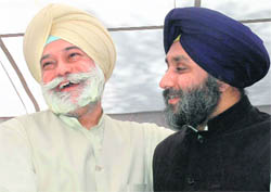 Bir Devinder Singh and SAD president Sukhbir Badal share a light moment after former's induction into the SAD at a function in Chandigarh on Tuesday.