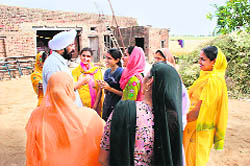 Baba Balkar Singh with a group of rural women.