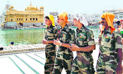 Jawans of paramilitary forces at the Golden Temple in Amritsar on Saturday.