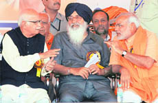 Prime ministerial candidate of the NDA LK Advani, Punjab Chief Minister Parkash Singh Badal and Gujarat CM Narendra Modi at a rally in Ludhiana on Sunday.