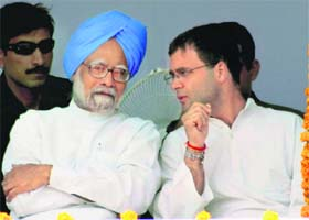FINAL PUSH: AICC general secretary Rahul Gandhi discusses a point with Prime Minister Manmohan Singh at an election rally in Amritsar