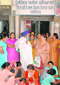 Anganwadi workers protest outside the Social Welfare Department office in Sector 34, Chandigarh, on Tuesday.