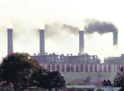 Ash being puffed out of chimneys of the thermal power station in Bathinda.