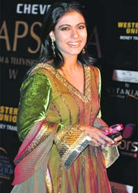 indian actress fake photos on Bollywood actress Kajol poses for a picture at the Apsara awards ...
