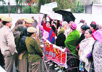 Members of the Mahila Sangharsh Samiti demand justice in the Rajnish death case