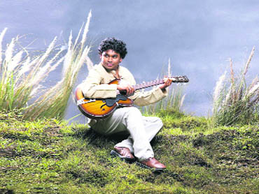 Composer A. R. Rahman plays his guitar at a hill station