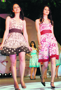 Models participate in a fashion show during Rose Festival 2010 at